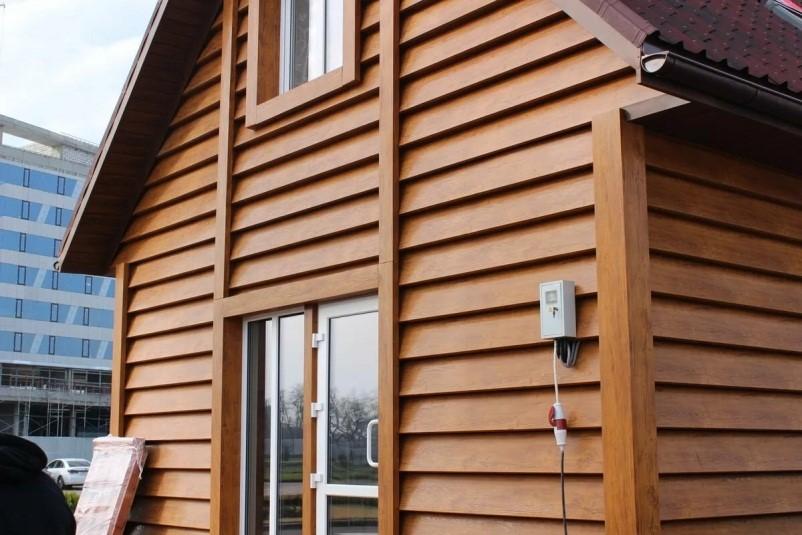 Облицовка дома сайдингом из дерева
